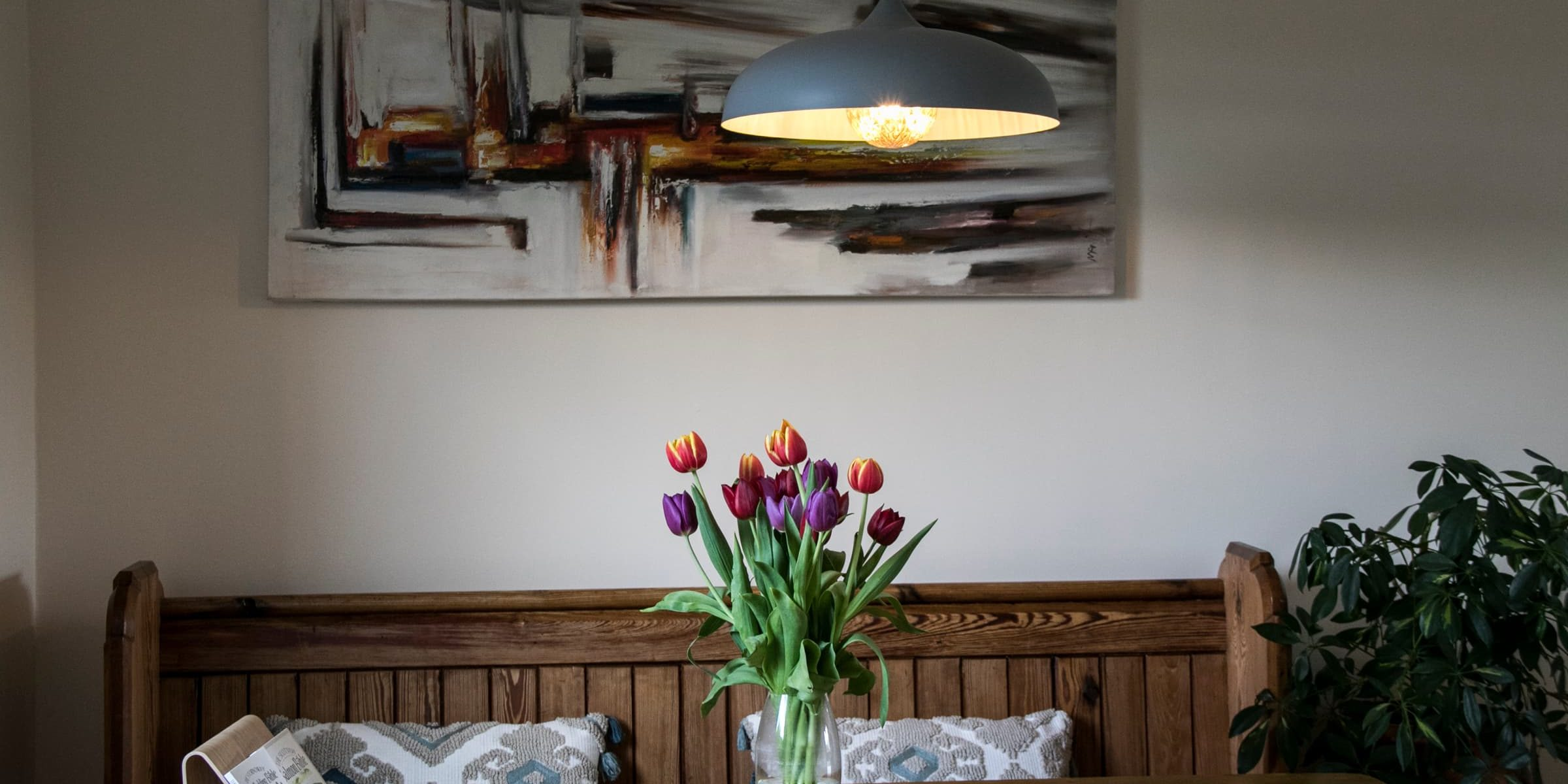 cozy looking dining area with bright flowers